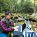 scientist monitoring water quality from solar powered field laboratory